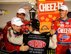 (Center) Jeff Gordon congratulates Hendrick Motorsports teammate Mark Martin and No. 5 crew chief Alan Gustafson in Darlington Raceway's Victory Lane after Martin won the NASCAR Sprint Cup Series Southern 500 Presented by GoDaddy.com on Saturday. (Photo Credit: Rusty Jarrett/Getty Images for NASCAR)