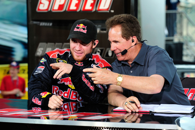 Pole-sitter Brian Vickers and Darrell Waltrip joke with fans during