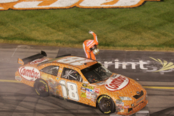 Kyle Busch does his trademark bow after winning the CROWN ROYAL presents The Russ Friedman 400 at Richmond International Raceway. The win came on Busch's 24th birthday and completed the weekend sweep at Richmond. (Photo Credit: Jason Smith/Getty Images)