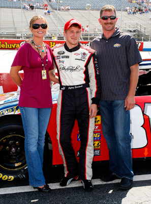 (Center) Jeffrey Earnhardt stands between his stepmother Rene and father Kerry before Jeffrey attempts to make his first NASCAR Nationwide Series race. Earnhardt was off of Kertus Davis' time by two-tenths of a second in qualifying Saturday at Dover International Speedway and was the only driver not to make the race. (Photo Credit: Jason Smith/Getty Images for NASCAR)
