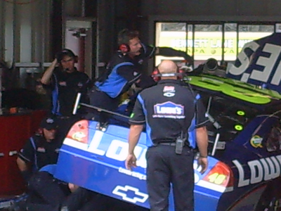 Crew members work on the No. 48 Lowe's Chevrolet during Sprint Cup practice sessions at Infineon Raceway on Saturday, June 20, 2009 (photo credit: The Fast and the Fabulous)
