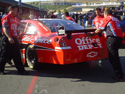 Crew members push the No. 14 Office Depot/Old Spice Chevrolet out of their garage stall during Sprint Cup practice sessions at Infineon Raceway on Saturday, June 20, 2009 (photo credit: The Fast and the Fabulous)