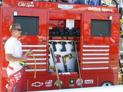 A member of the No. 14 Office Depot/Old Spice team prepares for the start of the Toyota/SaveMart 350 at Infineon Raceway on Sunday, June 21, 2009 (photo credit: The Fast and the Fabulous)