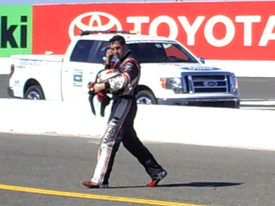 Sam Hornish Jr. attempts to walk to his pit stall after an incident on the track took him out of the race during the Toyota/SaveMart 350 at Infineon Raceway on Sunday, June 21, 2009 (photo credit: The Fast and the Fabulous)
