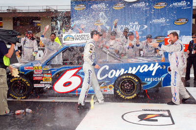The No. 6 Con-way Freight Ford Roush Fenway Racing team congratulate first-time NASCAR Camping World Truck Series winner Colin Braun in Victory Lane after the Michigan 200 Saturday at Michigan International Speedway in Brooklyn, Mich. (Photo Credit: Geoff Burke/Getty Images for NASCAR)