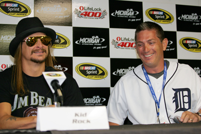 (Left to right) Kid Rock and the NFL's Detroit Lions head coach Jim Schwartz meet Sunday before the NASCAR Sprint Cup Series LifeLock 400 at Michigan International Speedway in Brooklyn, Mich. (Photo Credit: Todd Warshaw/Getty Images for NASCAR)