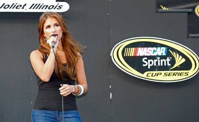 Singer Jessie James performs the National Anthem before Saturday's NASCAR Sprint Cup Series LifeLock.com 400 at Chicagoland Speedway in Joliet, Ill. (Photo Credit: Geoff Burke/Getty Images for NASCAR)