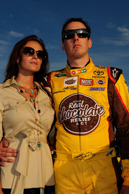 Kyle Busch, driver of the No. 18 M&M's Toyota, stands with his girlfriend Samantha Sarcinella during pre-race activities Saturday at Chicagoland Speedway before the start the NASCAR Sprint Cup Series LifeLock.com 400 in Joliet, Ill. (Photo Credit: Rusty Jarrett/Getty Images for NASCAR)
