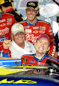 Team owner Rick Hendrick (left) and crew chief Alan Gustafson (top) celebrate with Mark Martin (right), driver of the No. 5 CARQUEST/Kellogg's Chevrolet, celebrates with in the Victory Lane after winning Saturday night's NASCAR Sprint Cup Series LifeLock.com 400 at Chicagoland Speedway. (Photo Credit: John Harrelson/Getty Images)