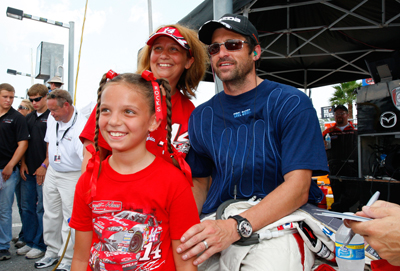 Patrick Dempsey, driver for Dempsey Racing, poses for a picture with Tony Stewart fans prior to the start of the Rolex Grand-Am Sports Car Series Brumos Porsche 250 at Daytona International Speedway on Saturday in Daytona Beach, Fla. (Photo Credit: Geoff Burke/Getty Images for NASCAR)