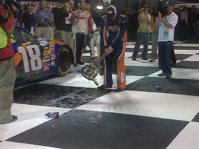 Kyle Busch smashes the guitar trophy at Nashville. (photo credit: Nationwide)