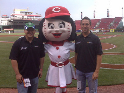 Stephen Leicht and Erik Darnell hanging out with Rosie Red prior to the game as a part of Kentucky Speedway Media Day in Cincinnati. (photo credit: Nationwide)