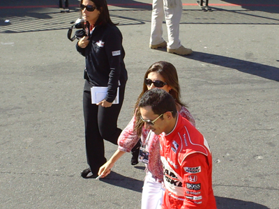 Helio Castroneves walks back to the garage with his girlfriend, Adriana Henao, after the race on Sunday, August 23, 2009 at the Indy Grand Prix of Sonoma at Infineon Raceway (photo credit: The Fast and the Fabulous)