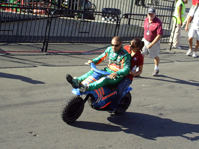 Tony Kanaan gets a ride back to the garage after the race on Sunday, August 23, 2009 at the Indy Grand Prix of Sonoma at Infineon Raceway (photo credit: The Fast and the Fabulous)