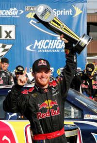 Race polesitter Brian Vickers, driver of the No. 83 Red Bull Toyota, celebrates with his firt trip to Michigan International Speedway's Victory Lane after winning the NASCAR Sprint Cup Series CARFAX 400 on Sunday. (Photo Credit: Jerry Markland/Getty Images for NASCAR)