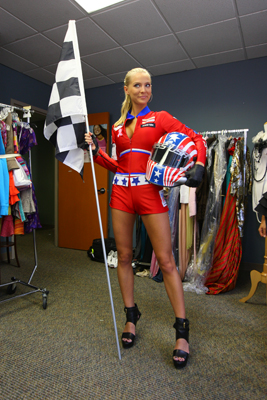 2009 Miss USA Kristen Dalton models her NASCAR-themed costume for the Miss Universe Pageant, where she hopes to take the checkered flag and win the title, at Miss Universe Pageant Headquarters in New York City. (Photo Credit: Mike Stobe/Getty Images for NASCAR)
