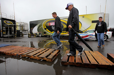 (Left to right) NASCAR Sprint Cup Series drivers Greg Biffle, Jamie McMurray and AJ Allmendinger walk through the garage after the drivers meeting for the Sunoco Red Cross Pennsylvania 500 Sunday at Pocono Raceway in Long Pond, Pa. (Photo Credit: Doug Pensinger/Getty Images)