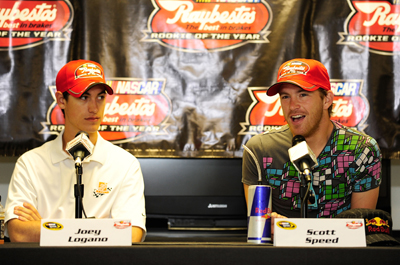 (Left to right) Raybestos Rookie of the Year Contenders Joey Logano, driver of the No. 20 Home Depot Toyota, and Scott Speed, driver of the No. 82 Red Bull Toyota, meet the media on Friday at Pocono Raceway during NASCAR Sprint Cup Series Sunoco Red Cross Pennsylvania 500 race weekend. (Photo Credit: Rusty Jarrett/Getty Images for NASCAR)