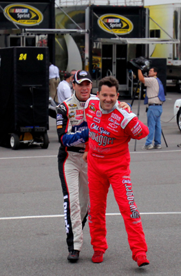 (Left to right) Jimmie Johnson, driver of the No. 48 Lowe's Chevrolet, grabs Tony Stewart, driver of the No. 20 Old Spice Swagger Chevrolet, as the two joked in the Pocono Raceway garage Friday before practice for the NASCAR Sprint Cup Series Sunoco Red Cross Pennsylvania 500. (Photo Credit: Doug Pensinger/Getty Images)