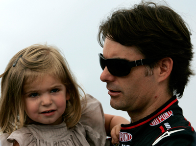 (Right to left) Jeff Gordon, driver of the No. 24 DuPont Chevrolet in the NASCAR Sprint Cup Series, holds his daughter Ella before the Heluva Good! Sour Cream Dips at The Glen on Sunday at Watkins Glen International in Watkins Glen, N.Y. The race was postponed by rain to Monday at noon ET. (Photo Credit: Todd Warshaw/Getty Images for NASCAR)