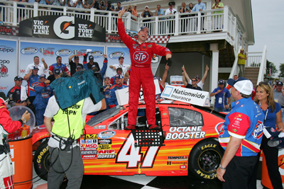 Marcos Ambrose, driver of the No. 47 STP Toyota, celebrates in victory lane after winning the NASCAR Nationwide Series Zippo 200 at Watkins Glen International on Saturday in Watkins Glen, N.Y. (Photo Credit: Todd Warshaw/Getty Images for NASCAR)