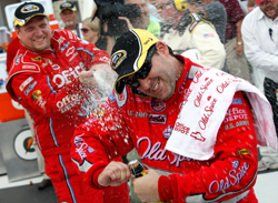 Tony Stewart, driver of the No. 14 Old Spice Chevrolet, gets doused with champagne on Monday after winning the NASCAR Sprint Cup Series Heluva Good! Sour Cream Dips at Watkins Glen International at Watkins Glen, N.Y. (Photo Credit: Chris Graythen/Getty Images)
