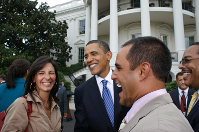 (Center) President Barack Obama welcomes to the White House Connie Montoya (left) and NASCAR Sprint Cup Series driver Juan Pablo Montoya (right) during NASCAR's visit to Washington, D.C. on Wednesday. (Photo Credit: NASCAR Public Relations)