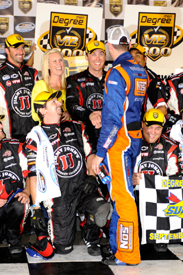 While in Victory Lane with wife DeLana Harvick, crew chief Ernie Cope and the rest of the No. 33 Jimmy John's Cheverolet team, race winner Kevin Harvick is congratulated by race runner-up Kyle Busch, driver of the No. 18 NOS Energy Drink Toyota, after the NASCAR Nationwide Series Degree V12 300 at Atlanta Motor Speedway on Saturday. (Photo Credit: John Harrelson/Getty Images for NASCAR)