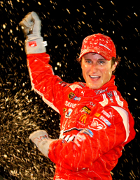 Kasey Kahne, driver of the No. 9 Budweiser Dodge and sixth in points in the standings, celebrates in Victory Lane after winning the NASCAR Sprint Cup Series Pep Boys Auto 500 at Atlanta Motor Speedway on Sunday. (Photo Credit: Jason Smith/Getty Images for NASCAR)