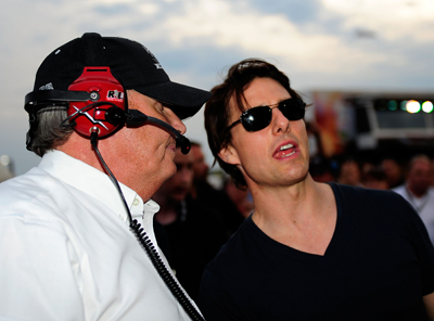 Actor Tom Cruise stands in the pits with NASCAR team owner Rick Hendrick, just before the start of Sunday's NASCAR Sprint Cup Series Pep Boys Auto 500 at Atlanta Motor Speedway. Cruise, who has become a familiar face at NASCAR races this season, will narrate an upcoming documentary about Hendrick that will cronicle the racing veteran's 25 years in the sport. (Photo Credit: Rusty Jarrett/Getty Images for NASCAR)