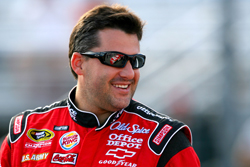 Tony Stewart, driver of the No. 14 Old Spice/Office Depot Chevrolet stands on the grid during qualifying for the NASCAR Sprint Cup Series Sylvania 300 at the New Hampshire Motor Speedway on Friday in Loudon, N.H. Sitting second in the Chase for the NASCAR Sprint Cup, Stewart will start Sunday's race in the outside of Row 1. (Photo Credit: Jason Smith/Getty Images for NASCAR)