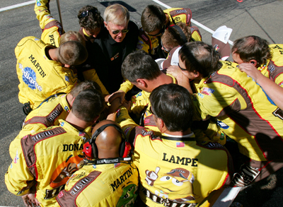 Team owner Joe Gibbs (top, black shirt) talks with the No. 18 M&M's crew before the NASCAR Sprint Cup Series Sylvania 300 at the New Hampshire Motor Speedway on Sunday in Loudon, N.H. (Photo Credit: Todd Warshaw/Getty Images for NASCAR)