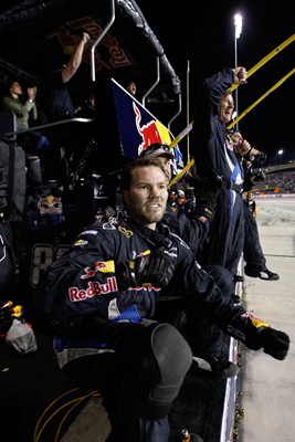Crew members for Brian Vickers' No. 83 Red Bull Toyota react after Vickers crossed the finish to secure the final berth in the Chase for the NASCAR Sprint Cup. (Photo Credit: Streeter Lecka/Getty Images)