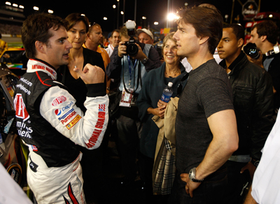 Tom Cruise, who is becoming a regular at NASCAR races, chats with Jeff Gordon on pit road prior to the Chevy Rock & Roll 400 at Richmond International Raceway. (Photo Credit: Streeter Lecka/Getty Images)