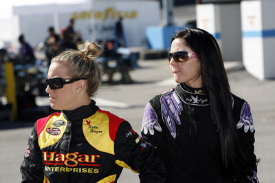 Drivers Katie Hagar and Natalie Sather watch as fellow drivers test NASCAR Camping World series cars on Day 2 of the NASCAR Drive for Diversity Combine at Motor Mile Speedway in Radford, Va. (Photo Credit: Tom Whitmore/Getty Images for NASCAR)