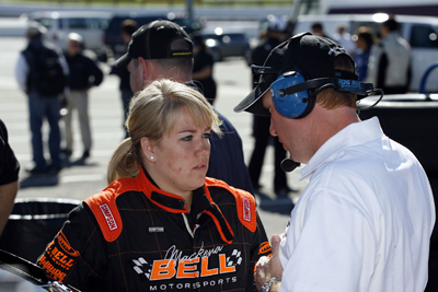 Mackena Bell, of Carson City, Nev., gets driving tips during Wednesday as part of NASCAR Driver for Diversity Combine at Motor Mile Speedway in Radford, Va. (Photo Credit: Tom Whitmore/Getty Images for NASCAR)