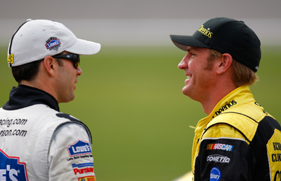 Points leader and three-time Chase for the Sprint Cup champion Jimmie Johnson (left), driver of the No. 48 Lowe's Chevrolet, chats with Kansas native Clint Bowyer (right), driver of the Cheerios/Hamburger Helper Chevrolet, during qualifying Friday for the NASCAR Sprint Cup Series Price Chopper 400 presented by Kraft Foods at the Kansas Speedway on Saturday. (Photo Credit: Geoff Burke/Getty Images for NASCAR)