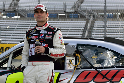 Jeff Gordon leans against his car while waiting to qualify for the TUMS Fast Relief 500 at Martinsville Speedway. Gordon will start Sunday's race from the outside pole. (Photo Credit: Jason Smith/Getty Images for NASCAR)