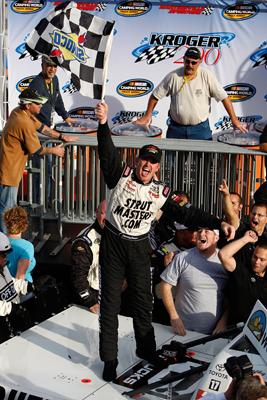 Timothy Peters celebrates winning the Kroger 200 at Martinsville Speedway, his hometown track. The win was Peters' first in the NASCAR Camping World Truck Series. (Photo Credit: Streeter Lecka/Getty Images)