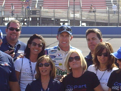 Carl Edwards takes a group photo with his new sponsor in the Nationwide Series for 16 races in 2010 the Copart 300 on Saturday, October 10, 2009 at Auto Club Speedway in Fontana, CA (photo credit: The Fast and the Fabulous)