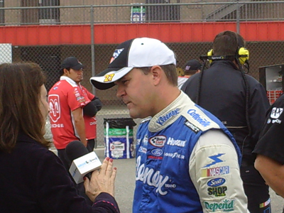Jason Keller chats with Sirius Satellite Radio's Claire B. Lang after his qualifying run for the Copart 300 on Saturday, October 10, 2009 at Auto Club Speedway in Fontana, CA (photo credit: The Fast and the Fabulous)
