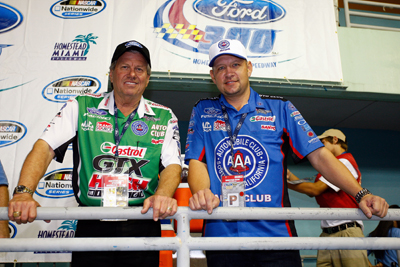 NHRA car owner John Force (left) and 2009 NHRA Funny Car Champion Robert Hight (right) served as honorary grand marshals for Saturday's NASCAR Nationwide Series Ford 300 at Homestead-Miami Speedway in Homestead, Fla. (Photo Credit: Geoff Burke/Getty Images for NASCAR)