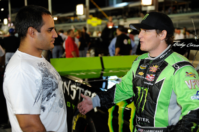 Miami resident Juan Pablo Montoya chats with Ricky Carmichael on pit road before the Ford 200 at Homestead-Miami Speedway. (Photo Credit: John Harrelson/Getty Images for NASCAR)