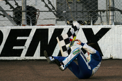 Edwards was unable to do his trademark backflip because of his previously broken foot, so he did a somersault to celebrate his win for the fans at Phoenix International Raceway. (Photo Credit: Todd Warshaw/Getty Images for NASCAR)