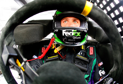 Denny Hamlin sits in his car waiting for practice to start for the Checker O'Reilly Auto Parts 500 presented by Pennzoil at Phoenix International Raceway. (Photo Credit: Jason Smith/Getty Images for NASCAR)