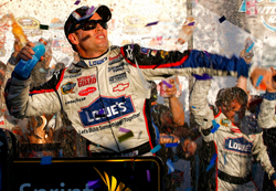 Jimmie Johnson celebrates winning the Checker O'Reilly Auto Parts 500 presented by Pennzoil at Phoenix International Raceway, his seventh victory of 2009. (Photo Credit: Jason Smith/Getty Images for NASCAR)