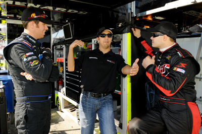 Matt Crafton (center), driver of the No. 88 Menards/McGuire-Nicholas Chevrolet, talks with Brian Scott, driver of the No. 16 Albertson's Toyota (left) and David Gilliland (right), driver of the No. 98 Menards Chevrolet, in the garage area during Thursday's practice for Friday's NASCAR Camping World Truck Series WinStar World Casino 350 at Texas Motor Speedway. Gilliland, who split practice time with Crafton in the No. 98 during the first practice, had the fastest time for most of the final practice (179.766 mph) until Crafton eclipsed his time with a posting of 180.180 mph. (Photo Credit: Rusty Jarrett/Getty Images for NASCAR)