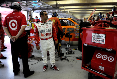Juan Pablo Montoya, driver of the No. 42 Target/Dream in Color Chevrolet, stands in the garage as crew members work on the car following a lap 176 accident in Turn 1 involving Brad Keselowski, Jeff Gordon and Carl Edwards during Sunday's NASCAR Sprint Cup Seris Dickies 500 at Texas Motor Speedway on November 8, 2009 in Fort Worth, Texas. Montoya finished the race in 37th place and is sixth in the Chase for the Sprint Cup, 236 points behind points leader Jimmie Johnson. (Photo Credit: Rusty Jarrett/Getty Images for NASCAR)