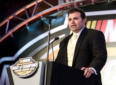 Donny Lia gives his championship speech. (Photo Credit: Chris Keane/Getty Images for NASCAR)