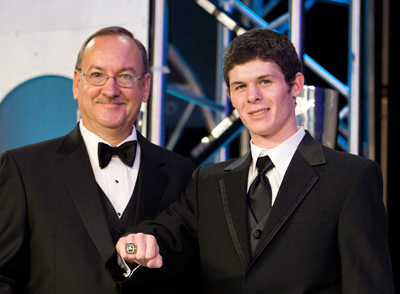 NASCAR's George Silbermann presents the NASCAR championship ring to Ryan Truex. (Photo Credit: Chris Keane/Getty Images for NASCAR)
